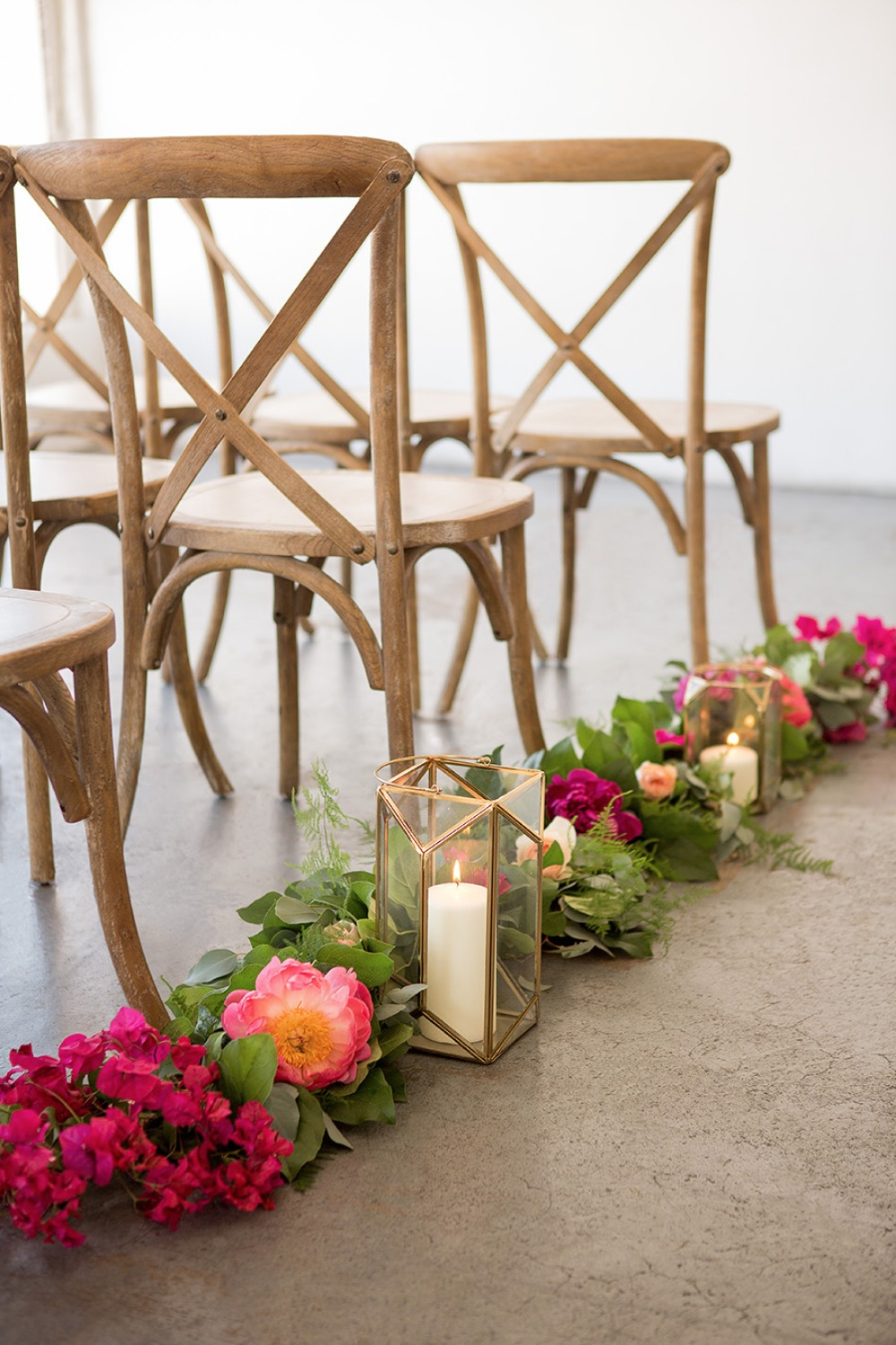 Florals and lantern aisle decor