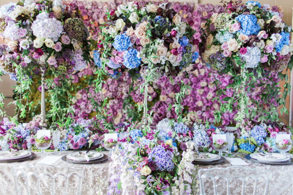 beautiful purple and blue flower filled wedding reception
