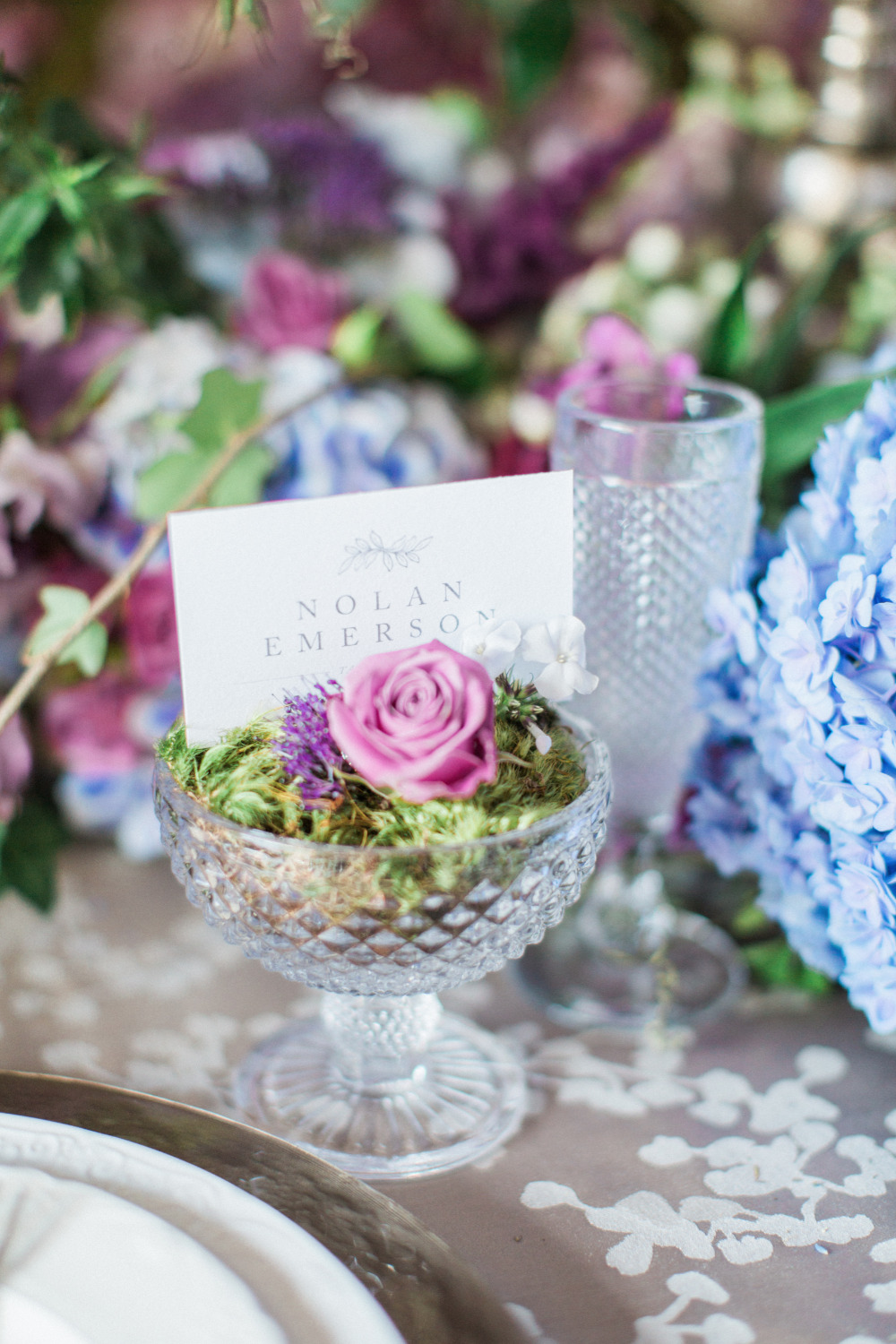purple flower and moss escort cards