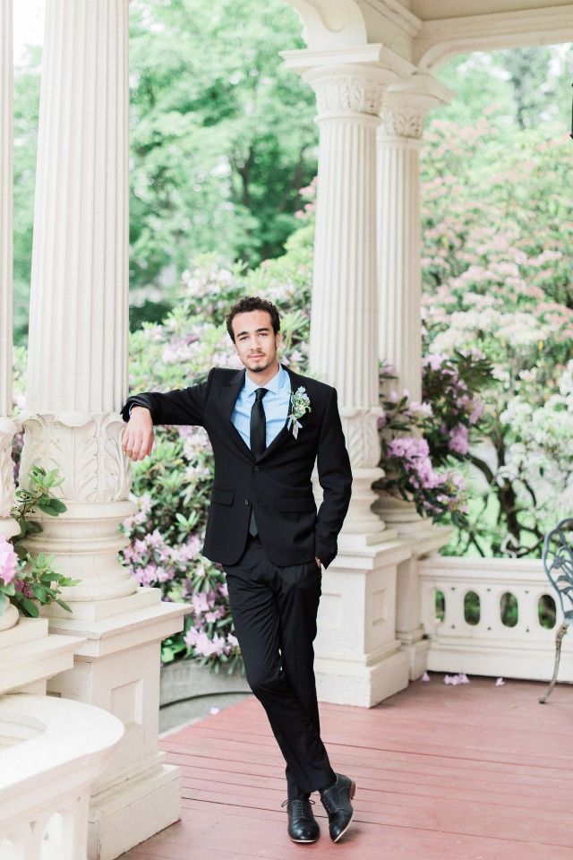 groom in black suit and light blue shirt