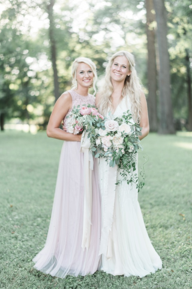 bridesmaid in soft pink dress from BHLDN