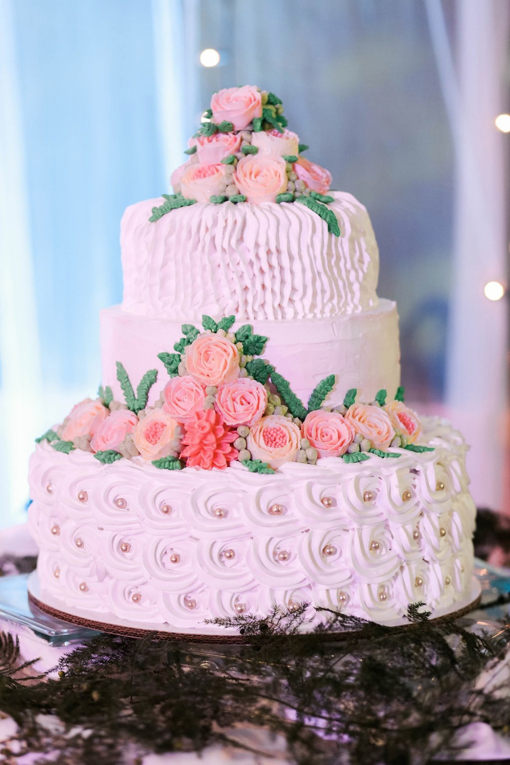 white and pink wedding cake made by the bride