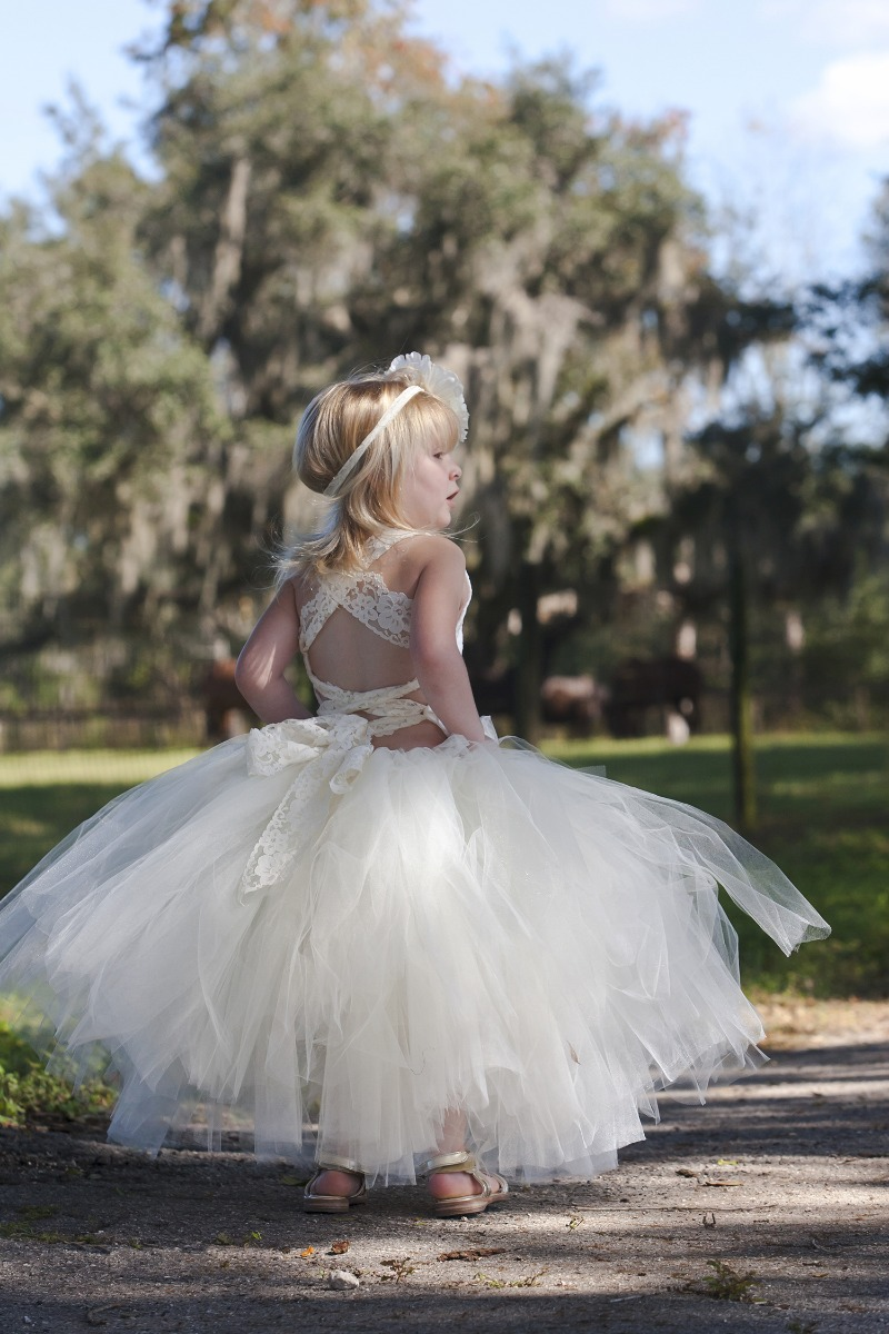 Your flower girl will be lovely in this open back ivory lace dress...