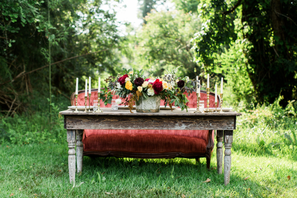 red velvet wedding sweetheart table seating