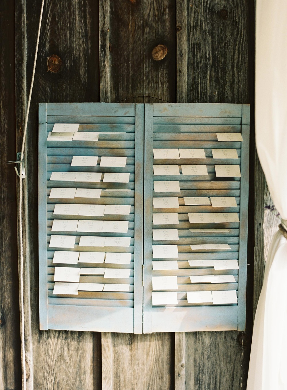 Vintage shutter escort card wall