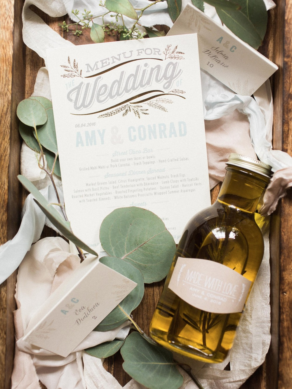 Wedding invite and olive oil wedding favor