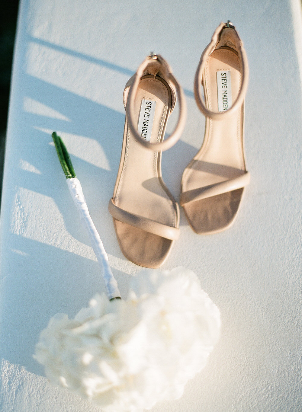 nude wedding shoes and white bouquet