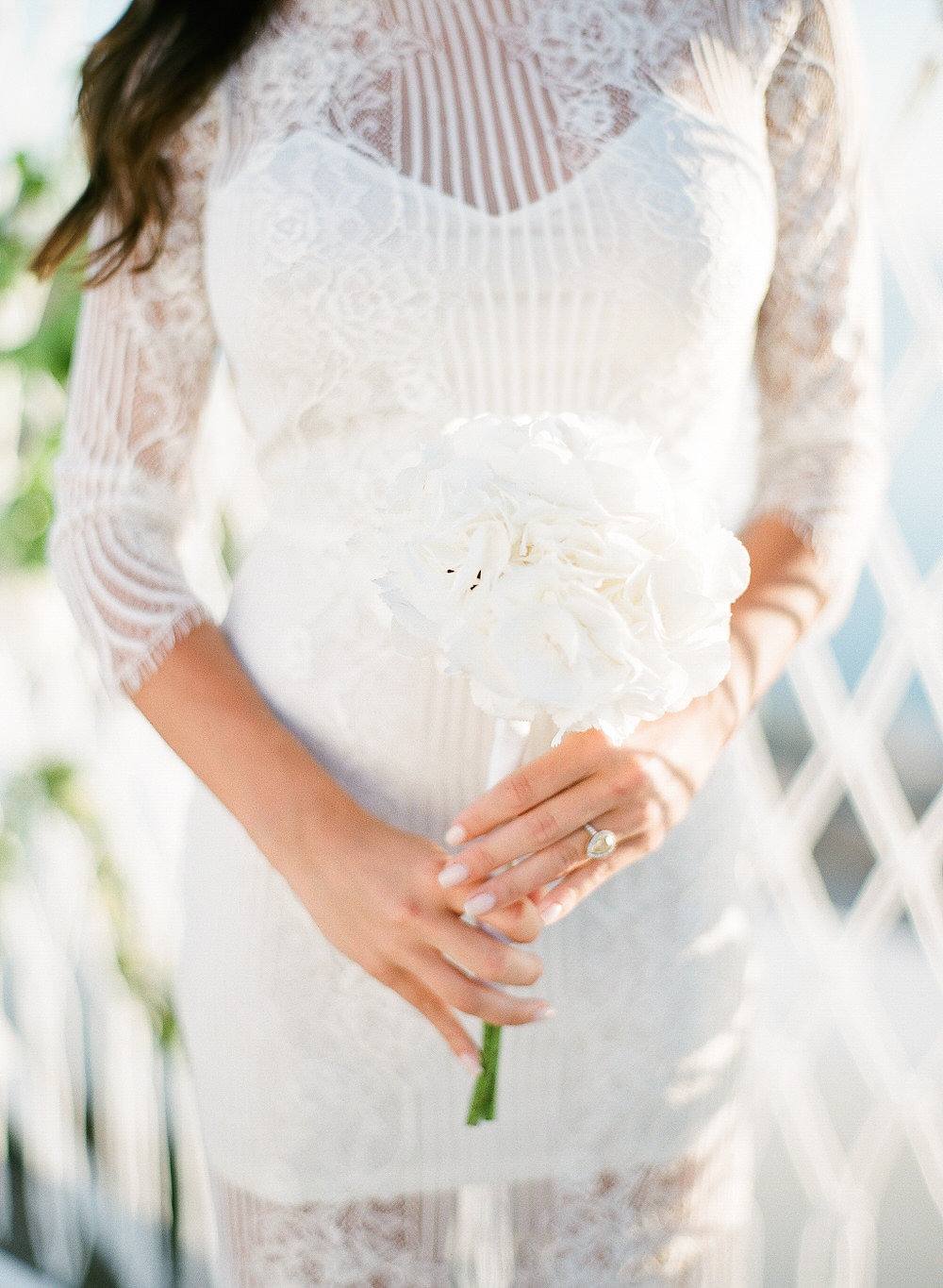 white engagement dress with hydrangea bouquet