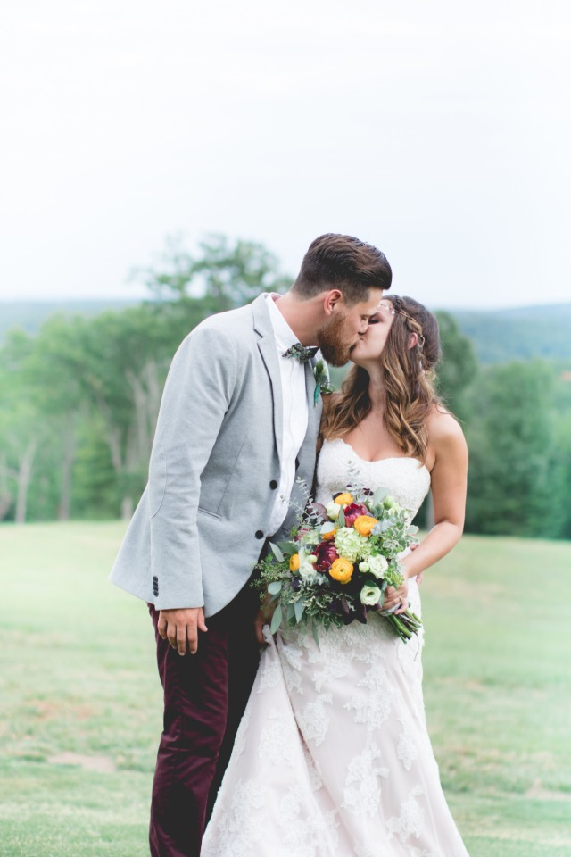 Bride and groom kiss portrait