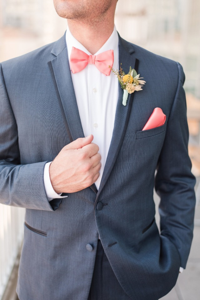 blue wedding suit with pink bow tie and pocket square