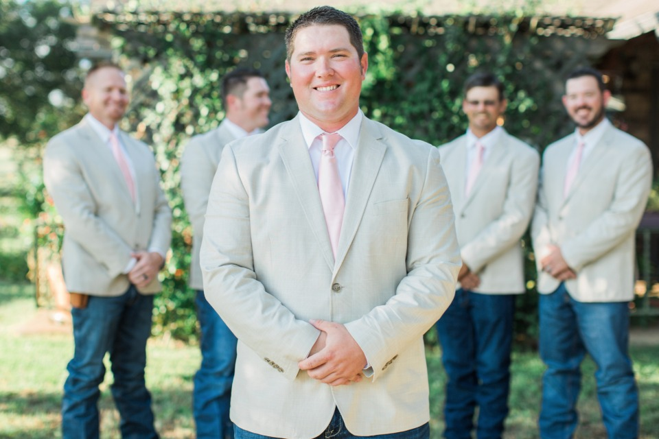 Beige suit with a pink tie