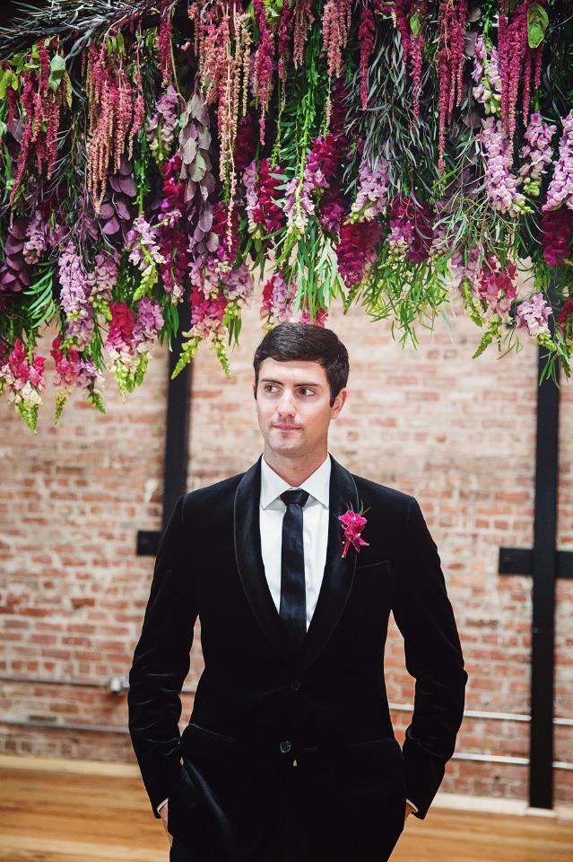 groom in classic black and white with fuchsia boutonniere