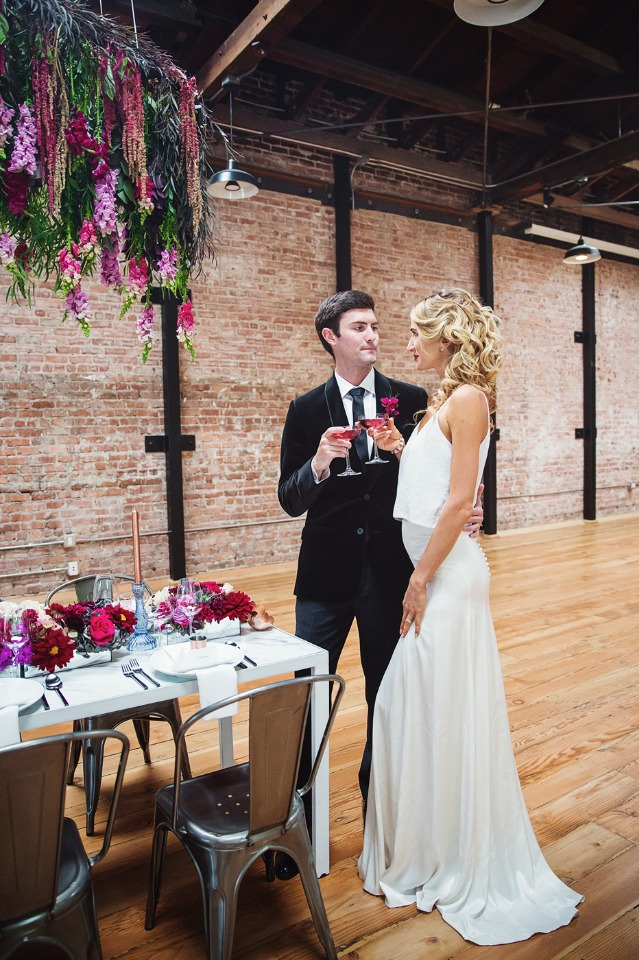bride and groom at their industrial fall reception