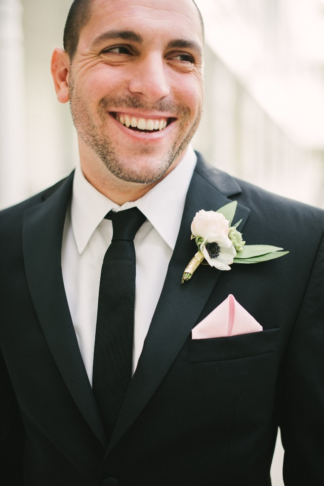 classic black suit groom style