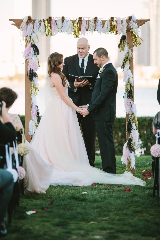 pink and gold tassel covered wedding arch