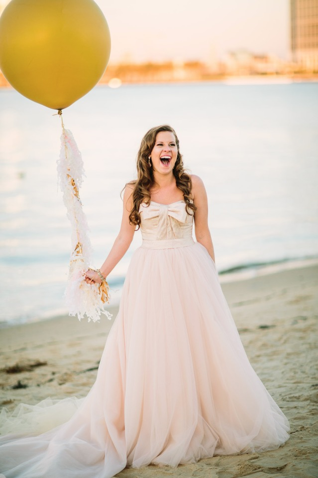 Vera Wang wedding dress and fun giant wedding balloon