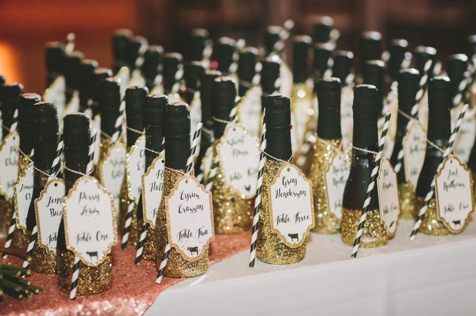 gold glitter mini champagne bottle escort cards