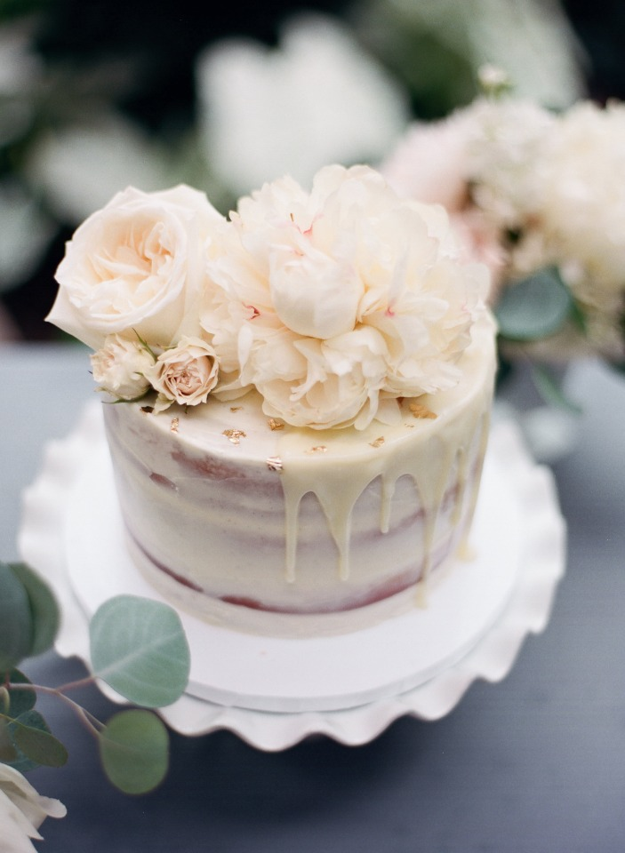 White sweetheart cake with flowers on top