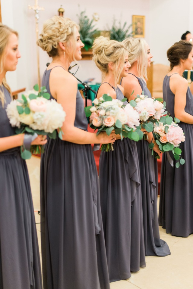 charcoal gray bridesmaids with white and peach bouquets