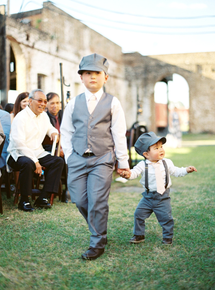 cute ring bearers with train conductor hats