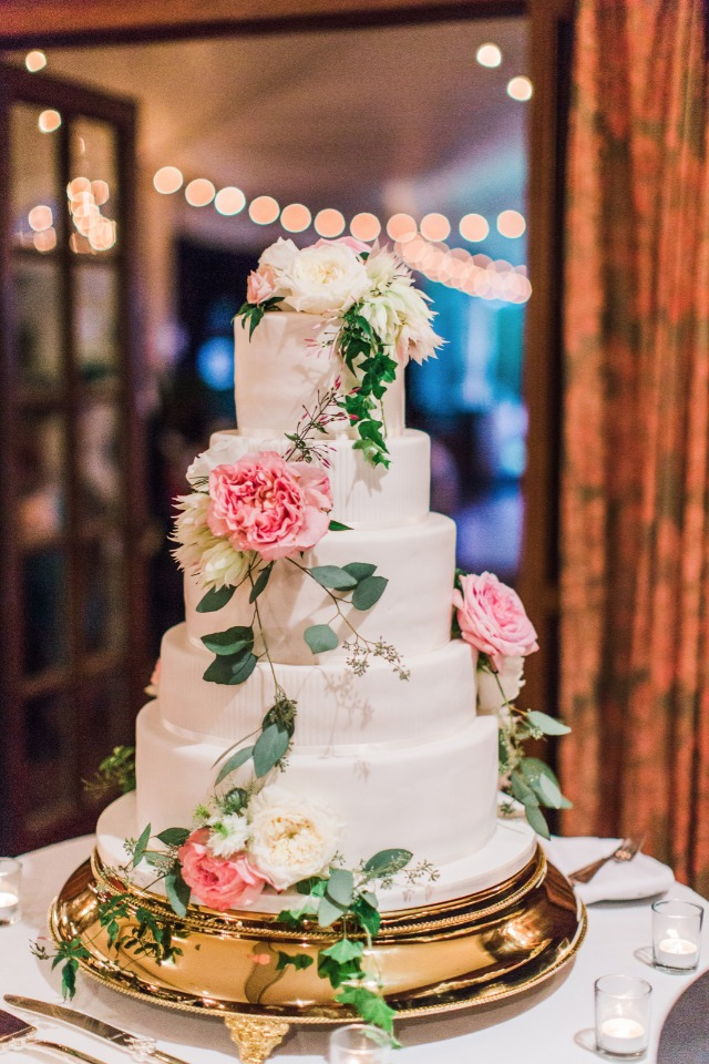 pink and white flower topped wedding cake