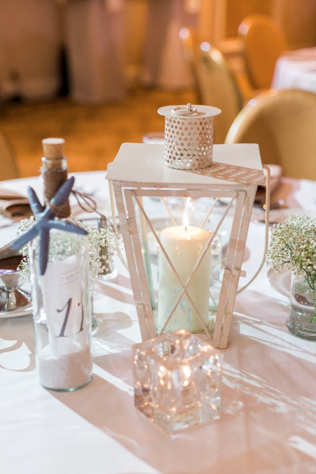 lantern and message in a bottle beach table decor