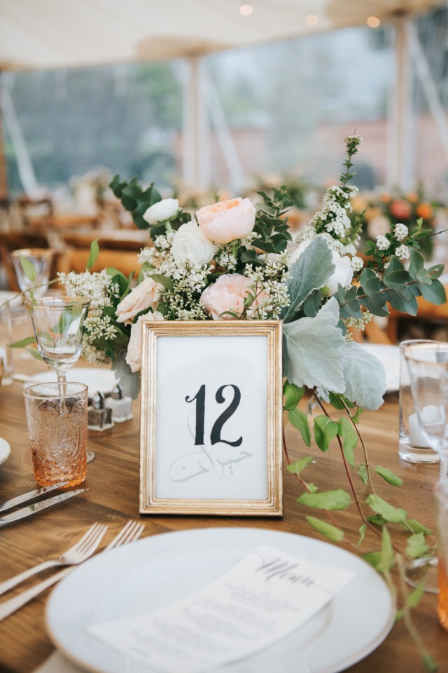 We love gold framed table numbers