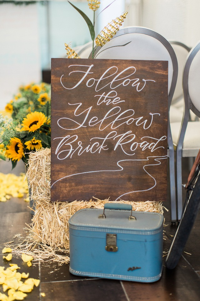 Follow the yellow brick road wedding sign