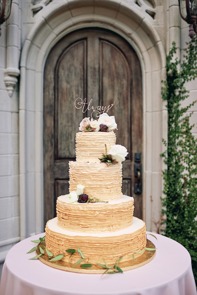 Gold ruffle wedding cake with florals