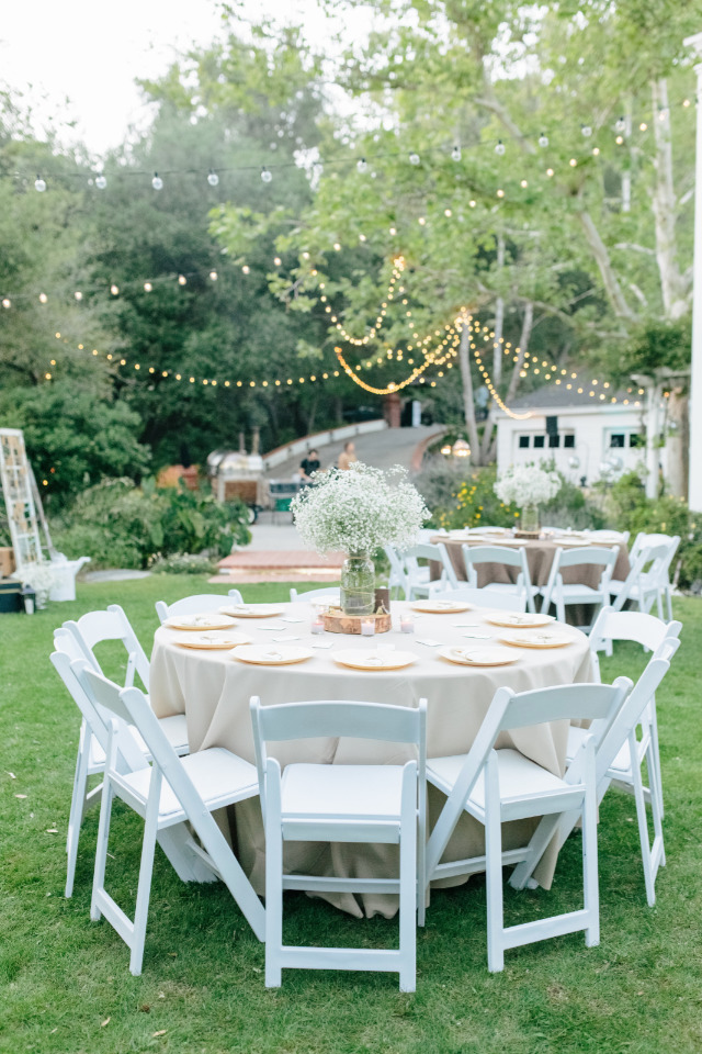 rustic wedding reception with bistro cafe lights