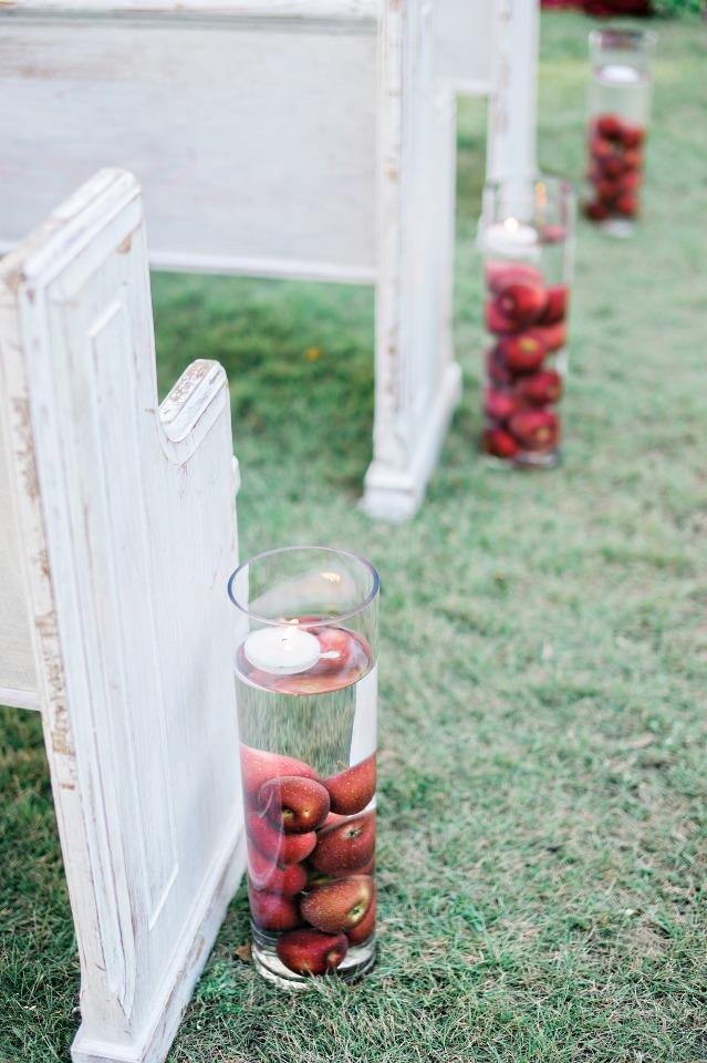 floating candles and apple aisle decor