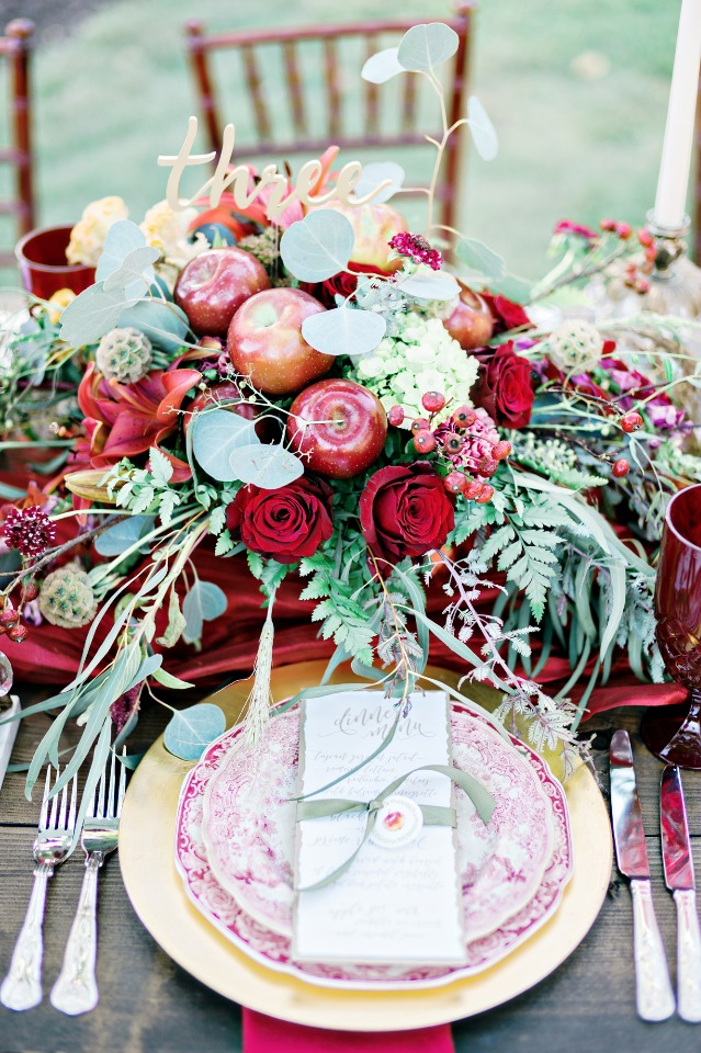 red and gold apple picking inspired centerpiece