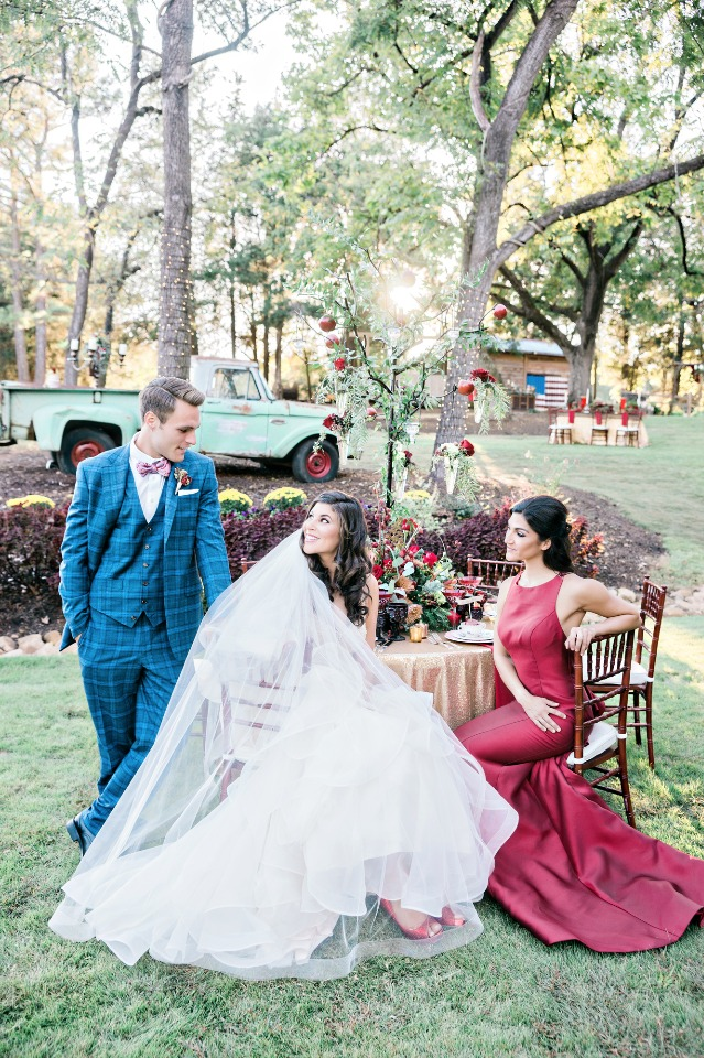 bride groom and maid of honor in blue white and red