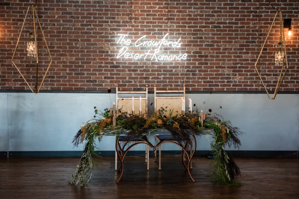 Modern sweetheart table with neon sign