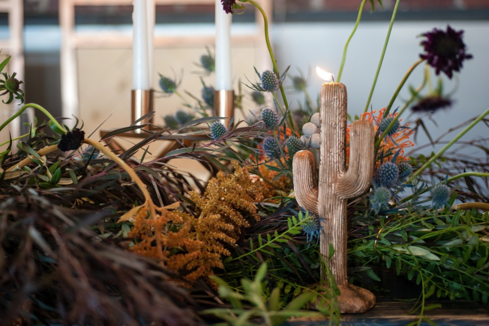 Desert floral centerpiece with cacti candle