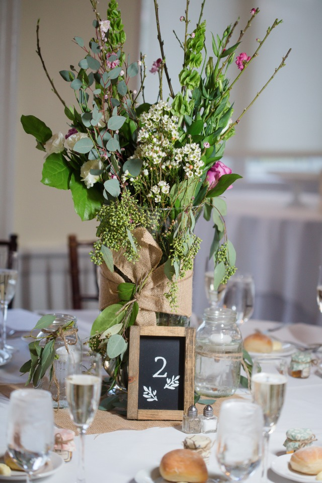 wildflower wedding reception centerpiece with chalkboard table number
