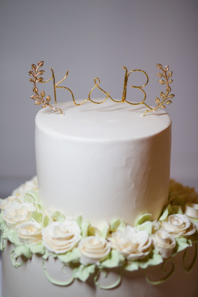 wedding cake with gold wire topper