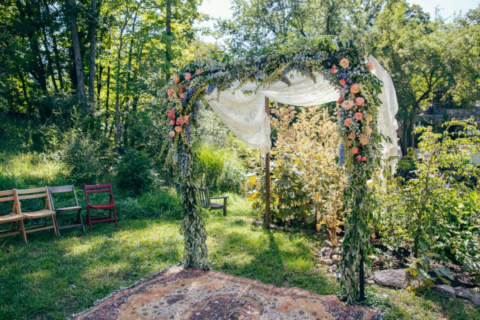 Rose floral ceremony arch