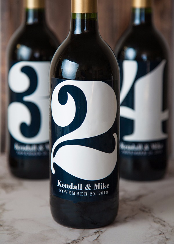 wine bottles with table numbers