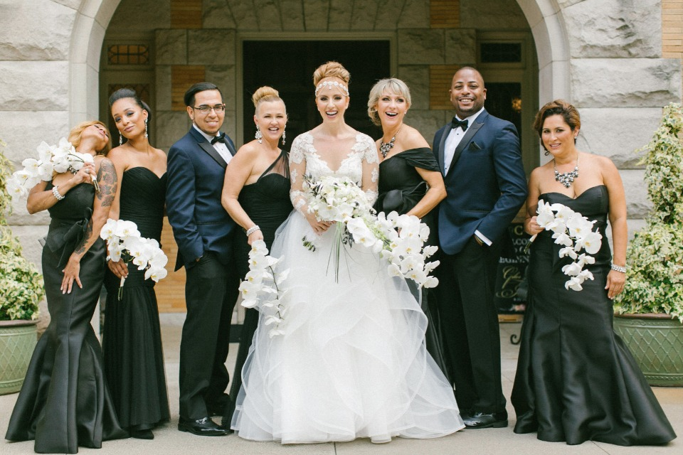 Bridal party in black gowns and navy suits