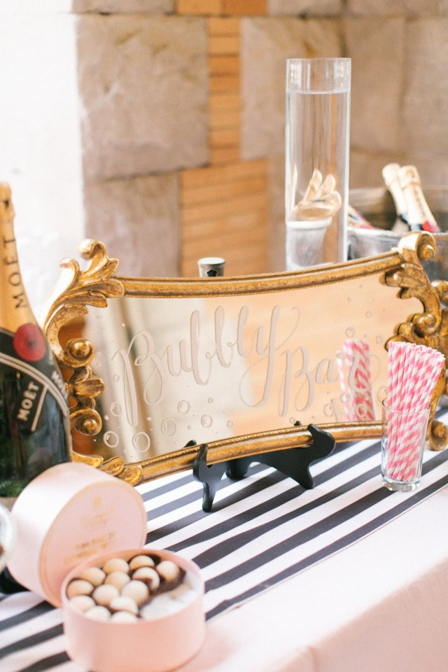 We love this gold bubbly bar mirror sign
