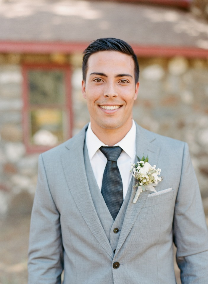 groom in light grey suit and charcoal tie