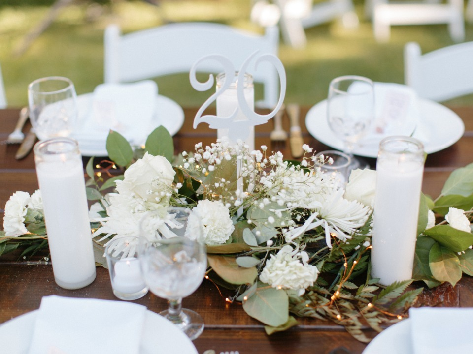simple white and elegant centerpiece and table number