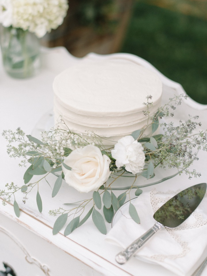 simple white and eucalyptus accented wedding cake