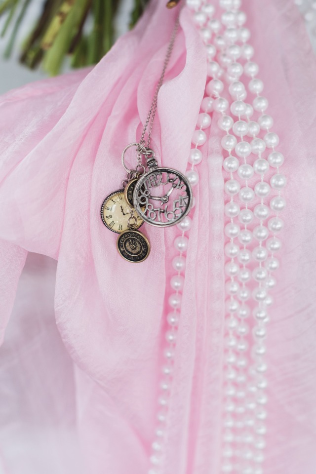 bouquet sash with strings of pearls and pocket watches