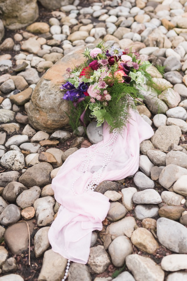 wedding bouquet with cascading pink sash