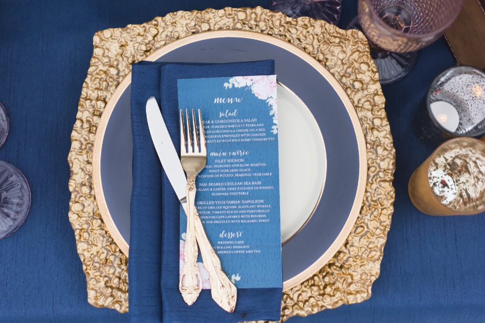 blue and gold place setting