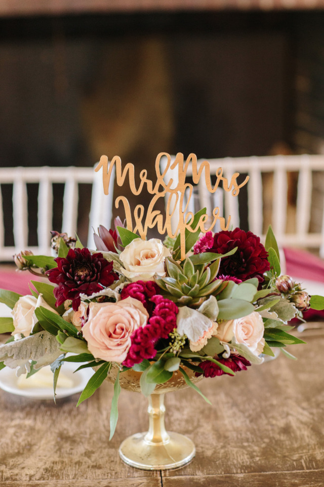 pink and red wedding centerpiece with succulents