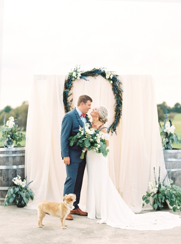 sweet blue white and blush wedding ceremony backdrop