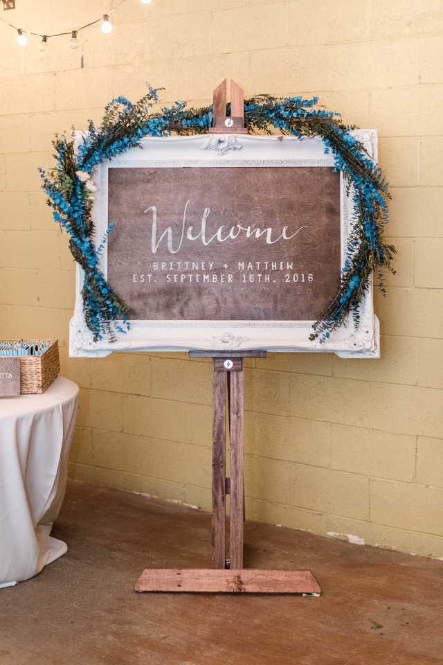garland accented welcome sign